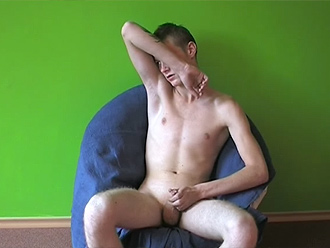 Young nude boy masturbates in the armchair