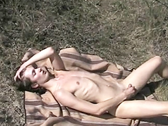 Naked boy masturbates outdoors